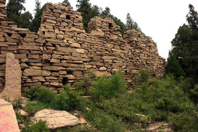 A section of the Great Wall of Qi made of stacked stones.
